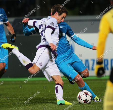 Stock Picture of Zenit's Andrey Arshavin (r) in Action Against Fabian Koch (l) of Austria Vienna During the Uefa Champions League Group G Soccer Match Between Fc Zenit St Petersburg and Fk Austria Vienna at the Petrovsky Stadium in St Petersburg Russia 01 October 2013 the Match Ended 0-0 Russian Federation St.petersburg