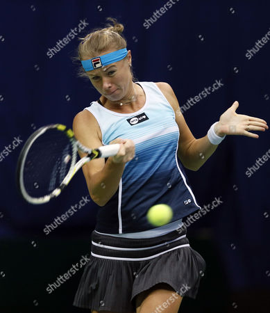 Vera Dushevina of Russia in Action Against Carla Suarez Navarro of Spain During Their Tennis Match at the Kremlin Cup Tennis Tournament in Moscow Russia 15 October 2013 Russian Federation Moscow
