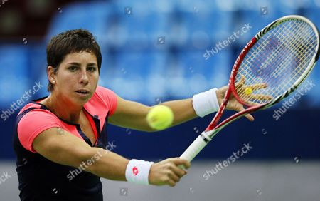 Carla Suarez Navarro of Spain in Action Against Vera Dushevina of Russia During Their Tennis Match at the Kremlin Cup Tennis Tournament in Moscow Russia 15 October 2013 Russian Federation Moscow