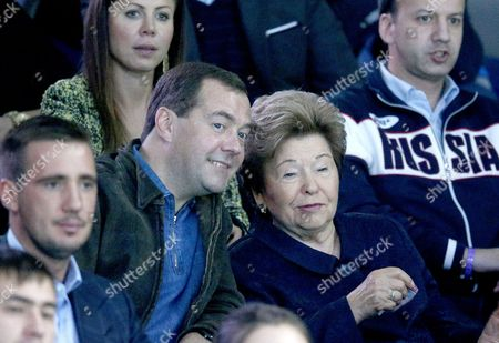 Russian Prime Minister Dmitry Medvedev (c-l) and Naina Yeltsin Widow of the Former Russian President Boris Yeltsin (c-r) Watch the Semi-final Match Anastasia Pavlyuchenkova of Russia Against Katerina Siniakova of Czech Republic During the Kremlin Cup Tennis Tournament in Moscow Russia 18 October 2014 Russian Federation Moscow