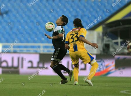 Stock Image of Al-shabab Player Rafinha (l) in Action For the Ball with Al-taawoun Player Yaseen Hamzah (r)áduring the Saudi Professional League Soccer Match Between Al-taawoun and Al-shabab at Prince Abdullah Bin Abdul Aziz Stadium in Buraidah Saudi Arabia 17 April 2015 Saudi Arabia Buraidah