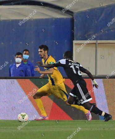 Al-taawoun's Jehad Al-hussain (l) in Action For the Ball with Al-shabab's Abdulmalik Al-khaibri (r)áduring the Saudi Professional League Soccer Match Between Al-taawoun and Al-shabab at Prince Abdullah Bin Abdul Aziz Stadium in Buraidah Saudi Arabia 17 April 2015 Saudi Arabia Buraidah
