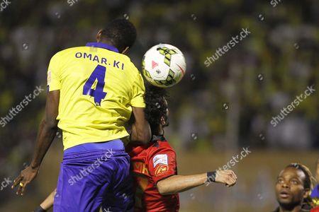 Al-nassr's Omar Hawsawi (l) in Action Against Al-raed's Mohammed Al Amri (r) During the Saudi Professional League Soccer Match Between Al-nassr Fc and Al-raed at the Prince Faisal Bin Fahd Stadium in Riyadh Saudi Arabia 14 February 2015 Saudi Arabia Riyadh