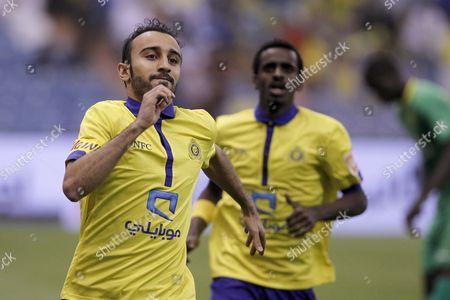 Al-nassr Player Mohammad Al Sahlawi (l) Celebrates After Scoring During the Saudi Professional League Soccer Match Between Al-nassr and Al-khaleej at King Fahd International Stadium Riyadh Saudi Arabia 20 February 2015 Saudi Arabia Riyadh