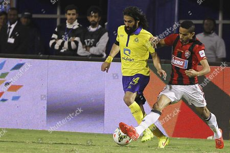 Al-nassr's Hussein Abdul Ghani (l) in Action Against Al-raed's Mohammed Al Burayk (l) During the Saudi Professional League Soccer Match Between Al-nassr Fc and Al-raed at the Prince Faisal Bin Fahd Stadium in Riyadh Saudi Arabia 14 February 2015 Saudi Arabia Riyadh