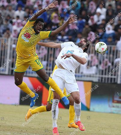 Al-orubah's Fawaz Fallatah (l) in Action Against Al-hilal's Georgios Samaras (r) During the Saudi Professional League Soccer Match Between Al-orubah and Al-hilal in Al-jawf Saudi Arabia 17 February 2015 Saudi Arabia Jawf