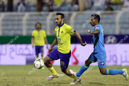 Al Nassr Player Mohammad Al Sahlawi (l) in Action Against Al-fateh Player During the Saudi Professional League Soccer Match Between Al Fateh and Al Nassr at Prince Abdullah Bin Jalawi Stadium Ihsaa Saudi Arabia 28 February 2015 Saudi Arabia Ihsaa