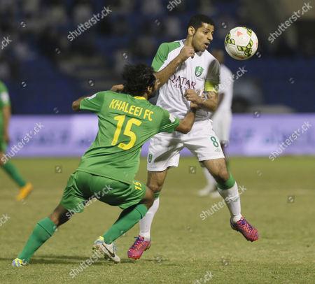 Al-khaleej Player Ahmed Al Mubarak (l) Fights For the Ball with Al-ahli Player Taisir Al Jassim (r) During the Saudi Professional League Soccer Match Between Al Khaleej and Al Ahli at Prince Mohamed Bin Fahd Stadium Dammam Saudi Arabia 28 February 2015 Saudi Arabia Dammam