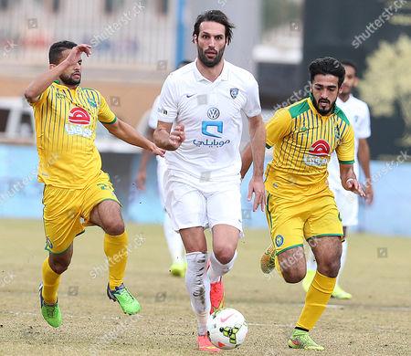 Al-hilal's Georgios Samaras (c) Controls the Ball Under Pressure From Al-orubah's Muhand Awad (l) and Fahad Al Rashidi (r) During the Saudi Professional League Soccer Match Between Al-orubah and Al-hilal in Al-jawf Saudi Arabia 17 February 2015 Saudi Arabia Jawf