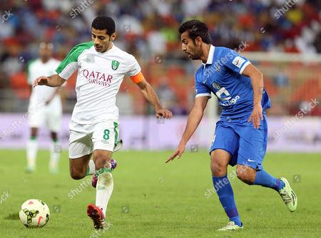 Taisir Al Jassim (l) of Al-ahli in Action Against Khalid Al Kabi (r) of Al-hilal During the Saudi Professional League Soccer Match Between Al-ahli Club and Al-hilal Sc at King Abdullah Al Jawhara Stadium in Jeddah Saudi Arabia 21 February 2015 Saudi Arabia Jeddah