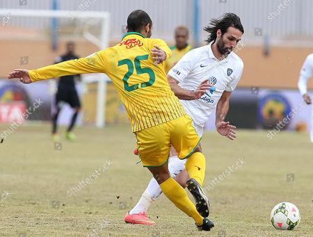 Al-orubah's Khodor Salameh (l) in Action Against Al-hilal's Georgios Samaras (r) During the Saudi Professional League Soccer Match Between Al-orubah and Al-hilal in Al-jawf Saudi Arabia 17 February 2015 Saudi Arabia Jawf