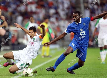 Taisir Al Jassim (l) of Al-ahli Club in Action Against Saud Khariri of Al-hilal (r) During the Saudi Professional League Soccer Match Between Al-ahli Club and Al-hilal Sc at King Abdullah Al Jawhara Stadium in Jeddah Saudi Arabia 21 February 2015 Saudi Arabia Jeddah
