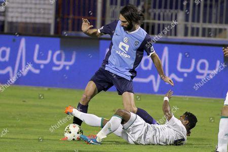 Georgios Samaras (l) of Alhilal Club in Action Against Sultan Al Yami (r) of Alshola During the Saudi Professional League Soccer Match Between Al-hilal and Alshola at the Prince Faisal Bin Fahd Stadium in Riyadh Saudi Arabia 06 February 2015 Saudi Arabia Riyadh