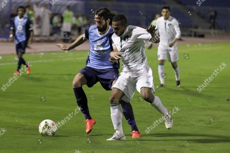 Georgios Samaras (l) of Alhilal Club in Action Against Ahmed Saad (r) of Alshola During the Saudi Professional League Soccer Match Between Al-hilal and Alshola at the Prince Faisal Bin Fahd Stadium in Riyadh Saudi Arabia 06 February 2015 Saudi Arabia Riyadh