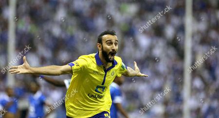 Al-nassr Player Mohammad Al Sahlawi Celebrates After Scoring a Goal During the Saudi Professional League Soccer Match Between Al Hilal and Al Nassr at King Fahd International Stadium in Riyadh Saudi Arabia 10 May 2015 Saudi Arabia Riyadh