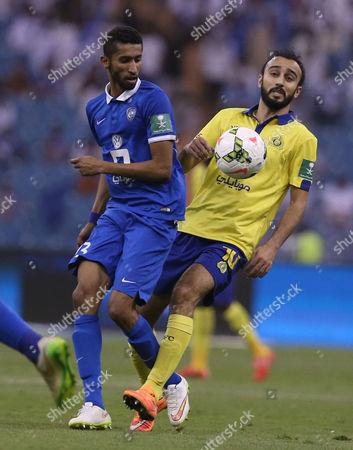 Al Hilal Player Salman Al Faraj (l) in Action with Al Nassr Player Mohammad Al Sahlawi (r) During the Saudi Professional League Soccer Match Between Al Hilal and Al Nassr at King Fahd International Stadium in Riyadh Saudi Arabia 10 May 2015 Saudi Arabia Riyadh