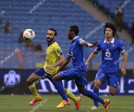 Al Nassr Player Mohammad Al Sahlawi (l) Vies For the Ball During the Saudi Professional League Soccer Match Between Al Hilal and Al Nassr at King Fahd International Stadium in Riyadh Saudi Arabia 10 May 2015 Saudi Arabia Riyadh