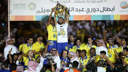 Al Nassr Player Mohammad Al Sahlawi Holds the Trophy of the Saudi Professional League at King Fahd International Stadium Riyadh Saudi Arabia 15 May 2015 Saudi Arabia Riyadh