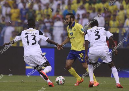 Al Nassr Player Mohammad Al Sahlawi (c) in Action with Al- Shabab Players Hassan Muath Fallatah (l) and Sayyaf Al Bishi (r) During the Saudi Professional League Soccer Match Between Al Nassr and Al Shabab at King Fahd International Stadium Riyadh Saudi Arabia 15 May 2015 Saudi Arabia Riyadh