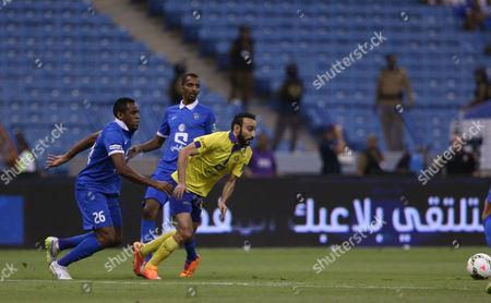Al Hilal Player Rodrigo Silva Digao (l) in Action with Al Nassr Player Mohammad Al Sahlawi (r) During the Saudi Professional League Soccer Match Between Al Hilal and Al Nassr at King Fahd International Stadium in Riyadh Saudi Arabia 10 May 2015 Saudi Arabia Riyadh