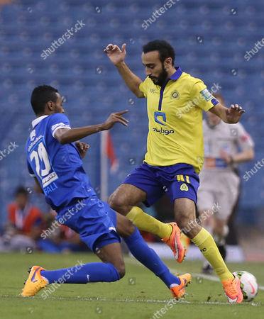 Al Hilal Player Mohammed Jahfali (l) in Action with Al Nassr Player Mohammad Al Sahlawi (r) During the Saudi Professional League Soccer Match Between Al Hilal and Al Nassr at King Fahd International Stadium in Riyadh Saudi Arabia 10 May 2015 Saudi Arabia Riyadh