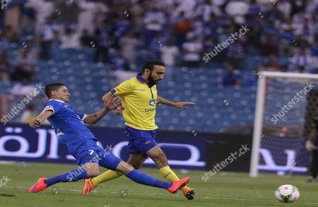 Al Hilal Player Thiago Neves (l) in Action with Al Nassr Player Mohammad Al Sahlawi (r) During the Saudi Professional League Soccer Match Between Al Hilal and Al Nassr at King Fahd International Stadium in Riyadh Saudi Arabia 10 May 2015 Saudi Arabia Riyadh