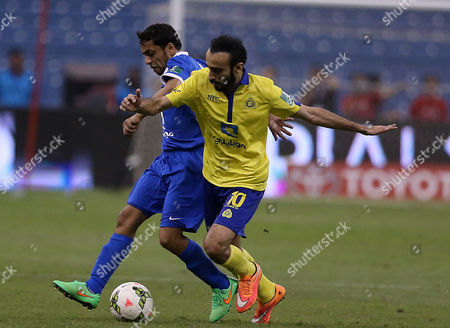 Al Nassr Player Mohammad Al Sahlawi (r) in Action During the Saudi Professional League Soccer Match Between Al Hilal and Al Nassr at King Fahd International Stadium in Riyadh Saudi Arabia 10 May 2015 Saudi Arabia Riyadh