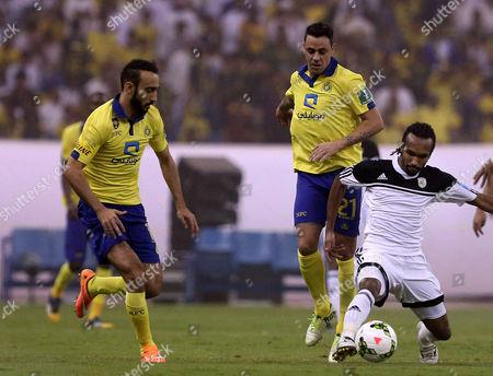 Al Nassr Player Mohammad Al Sahlawi (l) in Action with Al Shabab Player Abdulrahman Al Khaibary (r) During the Saudi Professional League Soccer Match Between Al Nassr and Al Shabab at King Fahd International Stadium Riyadh Saudi Arabia 15 May 2015 Saudi Arabia Riyadh