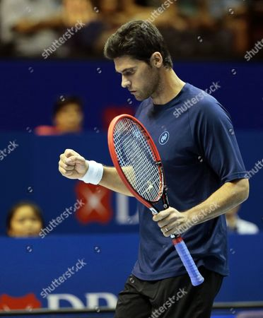 Mark Philippoussis of Australia Reacts During His Match Against Cedric Pioline of France at the International Premier Tennis League (iptl) in Singapore 04 December 2014 the Iptl Which Features Four Teams Made out of a Hybrid Mix of Current and Former Men's and Women's Players is on Its Second Leg in Singapore After Starting in the Phillipines and Will Continue in New Delhi and Conclude in Dubai Singapore Singapore