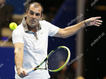 Cedric Pioline of France in Action Against Mark Philippoussis of Australia During Their Match of the International Premier Tennis League (iptl) in Singapore 04 December 2014 the Iptl Which Features Four Teams Made out of a Hybrid Mix of Current and Former Men's and Women's Players is on Its Second Leg in Singapore After Starting in the Phillipines and Will Continue in New Delhi and Conclude in Dubai Singapore Singapore