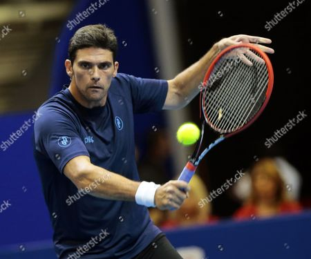 Mark Philippoussis of Australia in Action Against Cedric Pioline of France During Their Match of the International Premier Tennis League (iptl) in Singapore 04 December 2014 the Iptl Which Features Four Teams Made out of a Hybrid Mix of Current and Former Men's and Women's Players is on Its Second Leg in Singapore After Starting in the Phillipines and Will Continue in New Delhi and Conclude in Dubai Singapore Singapore