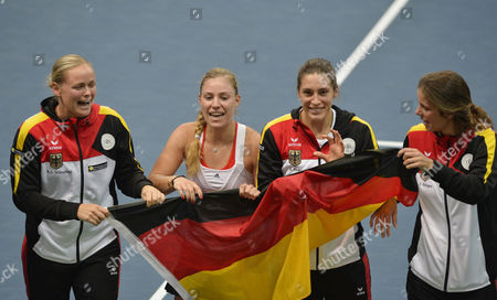 Members of the German Fed Cup Team (l-r) Anna-lena Gronefeld Angelique Kerber Andrea Petkovic and Julia Goerges Celebrate After Winning the Fed Cup World Group First Round Tie Between Slovakia and Germany in Bratislava Slovakia 09 February 2014 Slovakia (slovak Republic) Bratislava