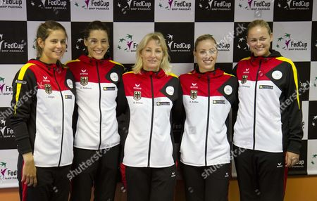 Stock Image of Members of the German Fed Cup Team (l-r) Julia Goerges Andrea Petkovic Captain Barbara Rittner Angelique Kerber and Anna-lena Gronefeld Pose For Photographers During a Press Conference in Bratislava Slovakia 04 February 2014 Germany Will Face Slovakia in a Fed Cup World Group First Round Tie on 08 and 09 February Slovakia (slovak Republic) Bratislava