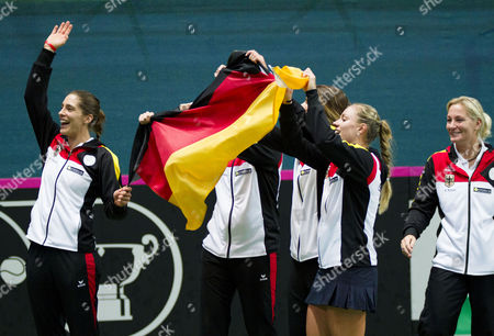 Stock Picture of Members of the German Fed Cup Team (l-r) Andrea Petkovic Anna-lena Gronefeld Julia Goerges Angelique Kerber and Captain Barbara Rittner Celebrate After Winning the Fed Cup World Group First Round Tie Between Slovakia and Germany in Bratislava Slovakia 09 February 2014 Slovakia (slovak Republic) Bratislava