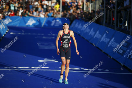Stock Image of Helen Jenkins of Great Britain Crosses the Finish Line to Take Second in the Itu Elite Women's Olympic Distance Triathlon in Cape Town South Africa 26 April 2014 This is the Second Event of Eight on the Itu World Triathlon Calendar South Africa Cape Town