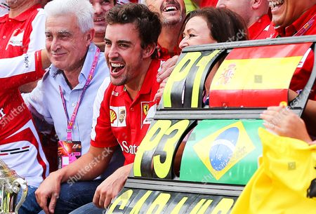 Stock Photo of Spanish Formula One Driver Fernando Alonso of Scuderia Ferrari Celebrates Together with His Parents Mother Aha Diaz and Father Jose Luis Alonso After Winning the 2013 Formula One Grand Prix of Spain at the Circuit De Catalunya in Montmelo Near Barcelona Spain 12 May 2013 Spain Montmelo