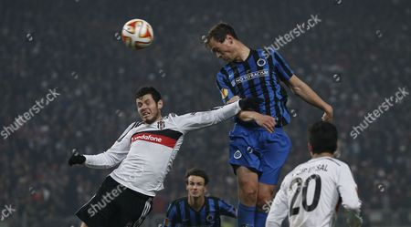 Club Brugge's Tom De Sutter (c) in Action Against Besiktas' Pedro Franco (l) During the Uefa Europa League Top 16 Second Leg Match Between Besiktas and Club Brugge in Istanbul Turkey 19 March 2015 Turkey Istanbul