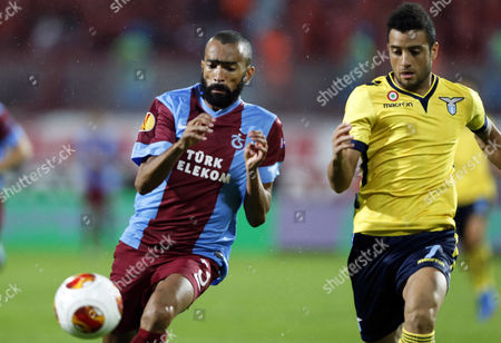 Lazio's Felipe Anderson (r) in Action Against Trabzonspor's Jose Bosingwa (l) During the Uefa Europa League Group J Soccer Match Between Trabzonspor and Ss Lazio at Avni Aker Stadium in Trabzon Turkey 03 October 2013 Turkey Trabzon