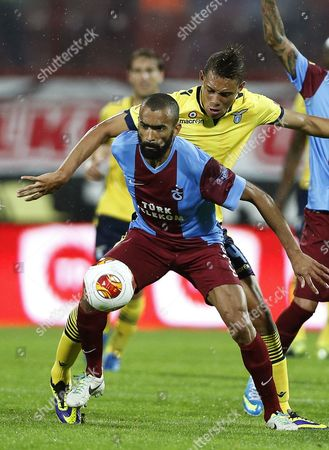 Lazio's Brayan Perea (back) in Action Against Trabzonspor's Jose Bosingwa (front) During the Uefa Europa League Group J Soccer Match Between Trabzonspor and Ss Lazio at Avni Aker Stadium in Trabzon Turkey 03 October 2013 Turkey Trabzon