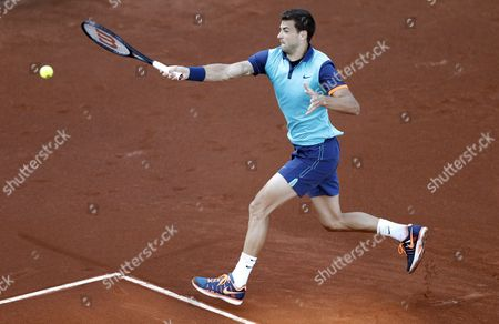 Grigor Dimitrov of Bulgaria Returns the Ball to Andrey Golubev of Kazakhistan During Their First Round Match at the Teb Bnp Paribas Istanbul Open Tennis Tournament in Istanbul Turkey 30 April 2015 Turkey Istanbul
