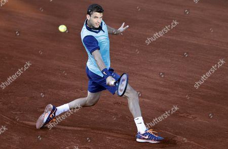 Grigor Dimitrov of Bulgaria Returns the Ball to Andrey Golubev of Kazakhistan During Their First Round Match of the Teb Bnp Paribas Istanbul Open Tennis Tournament in Istanbul Turkey 30 April 2015 Turkey Istanbul