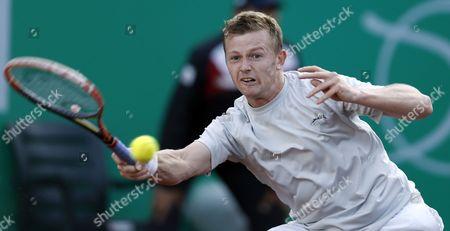 Andrey Golubev of Kazakhistan Returns the Ball to Grigor Dimitrov of Bulgaria During Their First Round Match of the Teb Bnp Paribas Istanbul Open Tennis Tournament in Istanbul Turkey 30 April 2015 Turkey Istanbul