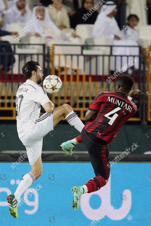 Ac Milan's Player Sulley Ali Muntari (r) Fights For the Ball with Real Madrid's Player Alvaro Arbeloa (l) During Their Soccer Match of Dubai Football Challenge Cup 2014 at the Sevens Stadium in Dubai United Arab Emirates on 30 December 2014 United Arab Emirates Dubai