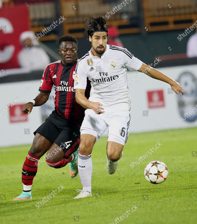 Real Madrid's Player Sami Khedira (r) Fights For the Ball with Ac Milan's Player Sulley Ali Muntari (l) During Their Soccer Match of Dubai Football Challenge Cup 2014 at the Sevens Stadium in Dubai United Arab Emirates on 30 December 2014 United Arab Emirates Dubai