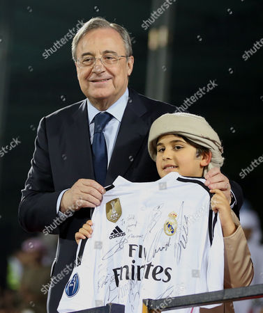 Stock Image of A Picture Made Available on 31 December 2014 of Spanish Club Real Madrid's President Florentino Perez (l) Posing with Sheikh Mohammed Bin Mansour Bin Zayed Al-nahyan (r) the Grandson of Both His Highness Sheikh Zayed Bin Sultan Al Nahyan the Late President of the Uae and His Highness Sheikh Mohammed Bin Rashid Al Maktoum Vice President and Prime Minister of the Uae and Ruler of Dubai Prior to the Soccer Match Between Real Madrid and Italian Team Ac Milan of the Dubai Football Challenge Cup 2014 at the Sevens Stadium in Dubai United Arab Emirates 30 December 2014 United Arab Emirates Dubai