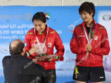 China's Li Xiaoxia (l) and Ding Ning (r) Receive Their Trophys After Winning Against Chinese Taipei Huang Yi-hua and Cheng I-ching the Final of Women's Doubles at Gac Group Ittf World Tour Grand Finals at Al-nasr Club in Gulf Emirate of Dubai United Arab Emirates on 12 January 2014 United Arab Emirates Dubai