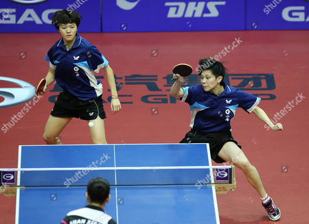 Huang Yi-hua (r) and Cheng I-ching From Chinese Taipei in Action Against Xiaona Shan and Zhenqi Barthel of Germany During Their Women's Doubles Semi-final Match For the Gac Group Ittf World Tour Grand Finals at Al-nasr Club in the Gulf Emirate of Dubai United Arab Emirates 12 January 2014 United Arab Emirates Dubai