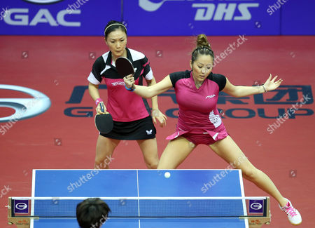 Xiaona Shan (l) and Zhenqi Barthel (r) of Germany in Action Against Huang Yi-hua and Cheng I-ching From Chinese Taipei During Their Women's Doubles Semi-final Match For the Gac Group Ittf World Tour Grand Finals at Al-nasr Club in the Gulf Emirate of Dubai United Arab Emirates 12 January 2014 United Arab Emirates Dubai