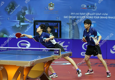 Huang Yi-hua (l) and Cheng I-ching From Chinese Taipei in Action Against Xiaona Shan and Zhenqi Barthel of Germany During Their Women's Doubles Semi-final Match For the Gac Group Ittf World Tour Grand Finals at Al-nasr Club in the Gulf Emirate of Dubai United Arab Emirates 12 January 2014 United Arab Emirates Dubai