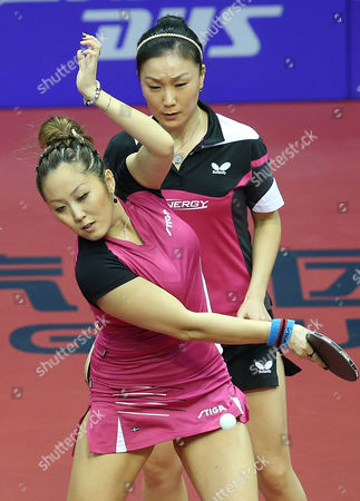 Xiaona Shan (back) and Zhenqi Barthel (front) of Germany in Action Against Huang Yi-hua and Cheng I-ching From Chinese Taipei During Their Women's Doubles Semi-final Match For the Gac Group Ittf World Tour Grand Finals at Al-nasr Club in the Gulf Emirate of Dubai United Arab Emirates 12 January 2014 United Arab Emirates Dubai